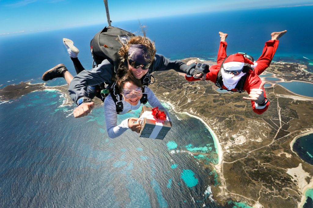 A tandem skydive whilst opening a present from Santa